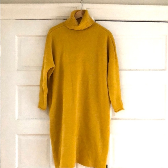 Long sweater with high neckline and back detail